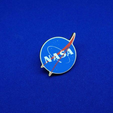 Значок Наса (NASA)